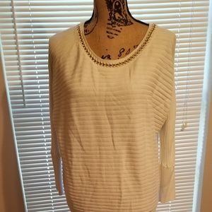Cream sweater with chain
